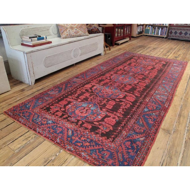 With tulips and carnations everywhere, this antique village rug is a direct descendant Ottoman Turkish weavings from the...