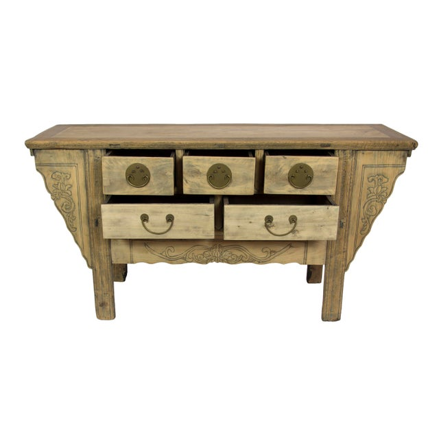 Constructed around 1900, this antique Gangsu sideboard has aged beautifully over the years and is as much as conversation...