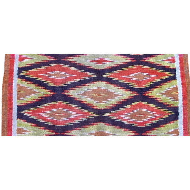 This piece has a heavy thick weave and would lay on the floor better than most.