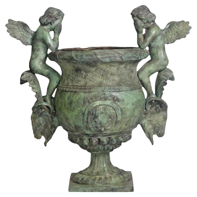 Classical Style Cast Bronze Verde Patina Urn With Two Cupids and Rams' Heads For Sale