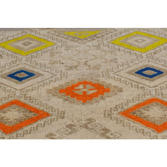 Vintage Oushak hand made rug with great colors and geometric pattern.