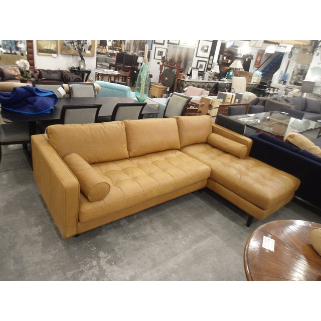 This is a warm tan leather sofa, right chaise, made of 100% authentic full grain leather. It's in good condition, and down...