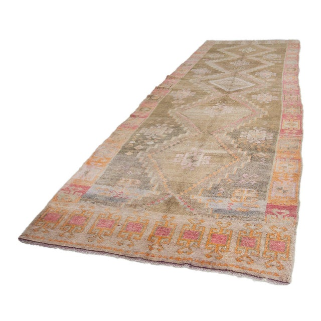 Handknotted vintage wool rug from Kars region of Turkey. Approximately 55-65 years old. In very good condition.