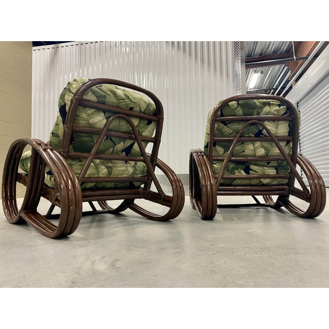 """A beautiful pair of three band """"Pretzel"""" style rattan lounge or club chairs. They are reminiscent of the Paul Frankl..."""
