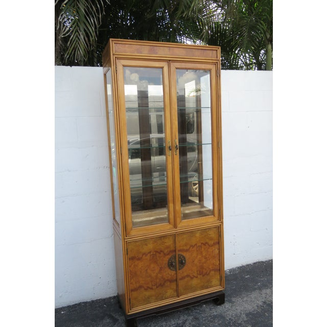 This brilliant Display Cabinet is made of wood, solid wood, burl wood veneer, glass, and is in good condition. This...