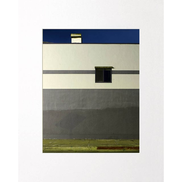 This contemporary color photograph creates an inviting composition from an otherwise ordinary environment. Note from the...