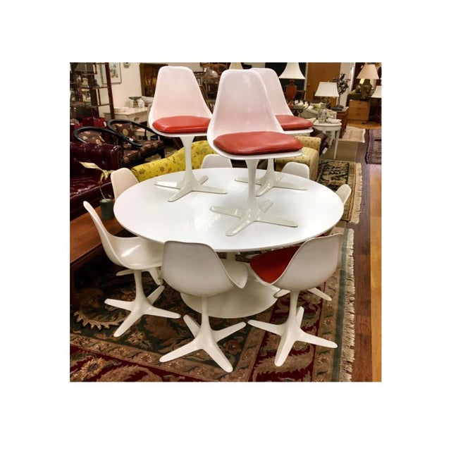 True period tulip set from famed vintage USA maker Burke Industries that features a five foot round tulip table and ten...