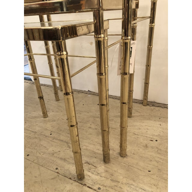 Versatile set of 3 mid-century brass and glass faux bamboo nesting tables in graduating sizes.