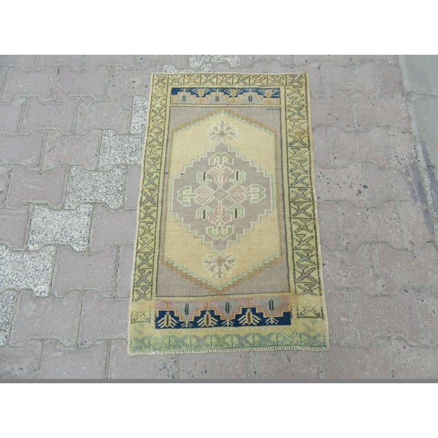 Handknotted Vintage rug from Oushak region of Turkey. Approximately 45-55 years old.In very good condition.