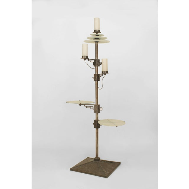 French Art Deco wrought iron standing lamp with 2 adjustable round frosted glass platform shelves below 2 adjustable side...