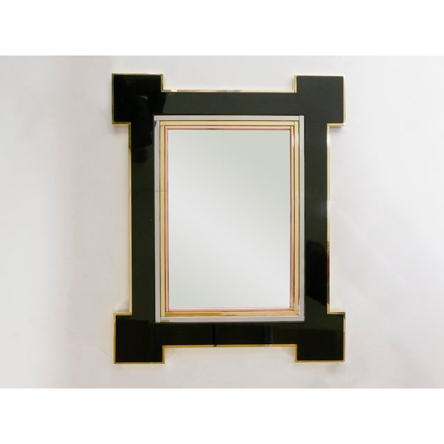 The black lacquer and mix of metals with brass copper and chrome layers make up the decorative frame of this beautiful and...