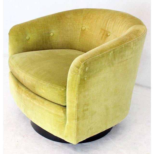 Mid-Century Modern Milo Baughman swivel barrel back mustard green velvet upholstery lounge chair.