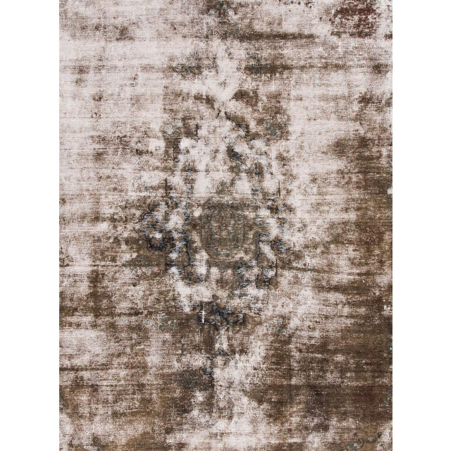 Antique hand-knotted Persian Kerman distressed rug with an all-over motif. This piece has great detailing and a beautiful...
