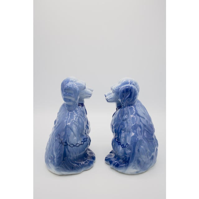 Very rare pair of antique staffordshire style spaniels. Unique blue glaze color with hand-painted chain detail.