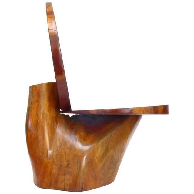 A wonderful side chair beautifully constructed of redwood. An asymmetrical, free-edge stump base holding a disc seat and...