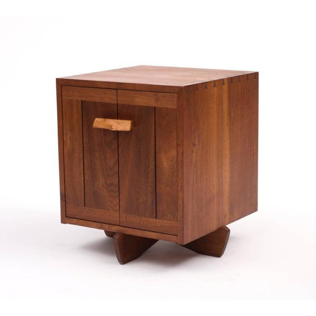 A stunning Kornblut case by George Nakashima in black walnut and maple burl, 1970s. Piece comes with a document of...