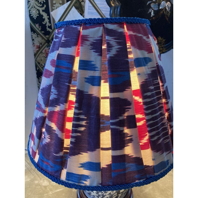 """A lampshade handmade from a woven silk/cotton Ikat textile, embellished with vintage trim. Top 8"""" bottom 16"""" side 12.5"""""""