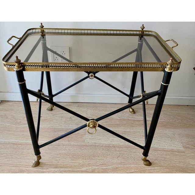 French tray table with smoked glass tray and lion detailing, with brass hoof feet - a wonderful table with removable tray...