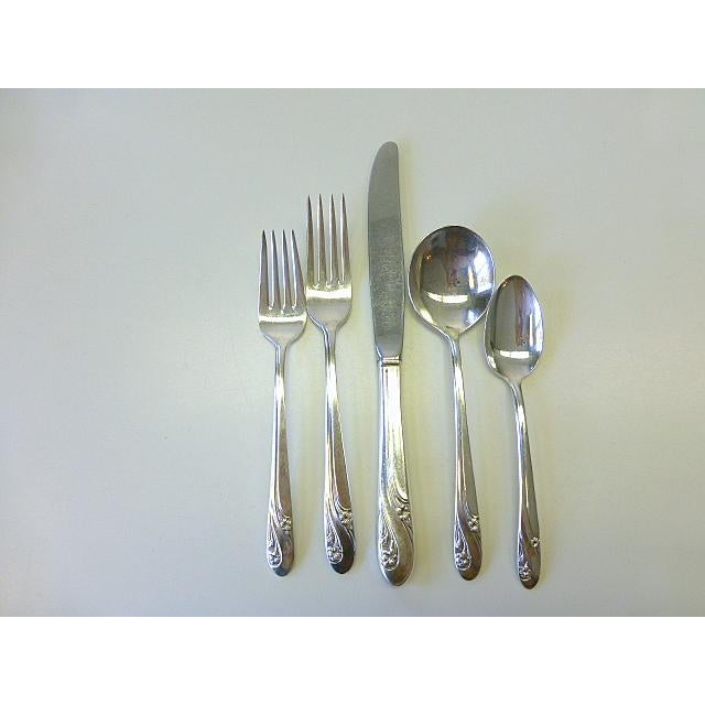 "This is a beautiful 1952 vintage Holmes & Edward / IS ""Romance"" pattern silver plate flatware set. The flowers look to be..."