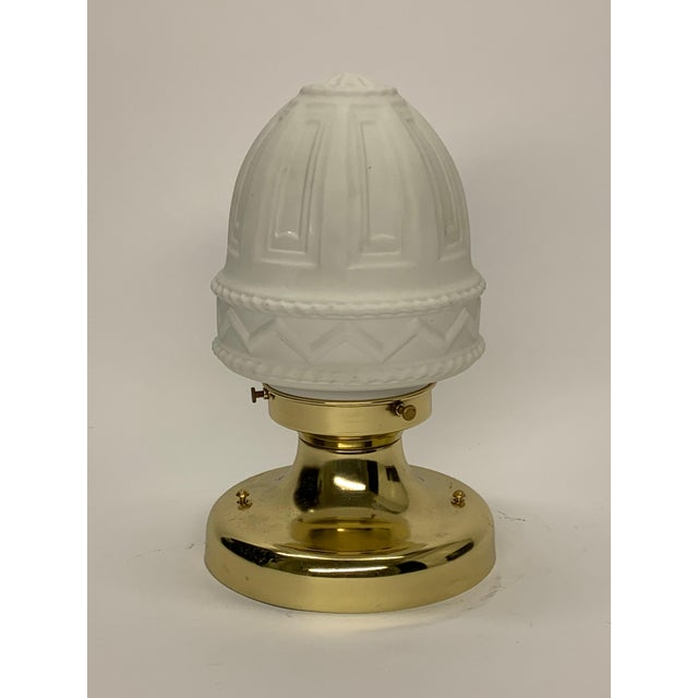 Classically styled light fixture with newly polished vintage fixture. Inside a porcelain socket can take up to a 100w...