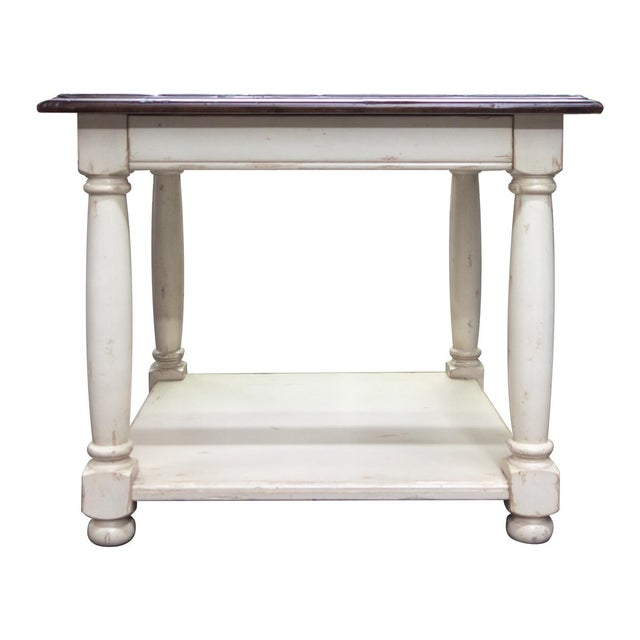 Featuring Country English end table with drawer and shelf, shown in Antique Brittany finish top and Old World White finish...