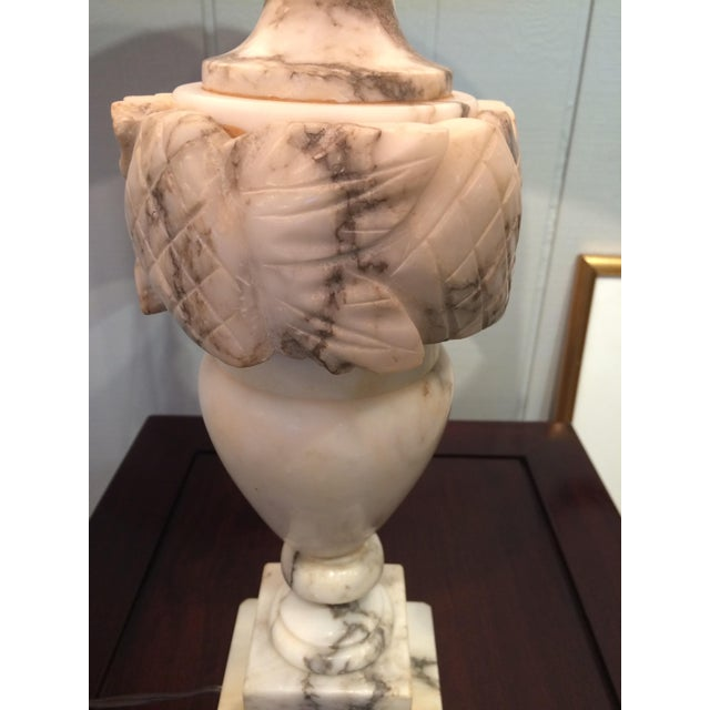 Two beautiful medium sized white and grey marble table lamps having gorgeous urn shape and decorative carving, including...