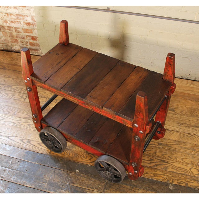Industrial Bar Cart – rolling two-tier cart on castors. Made of wood, steel, cast iron. Shelf heights are 8 1/4″ and 24″....