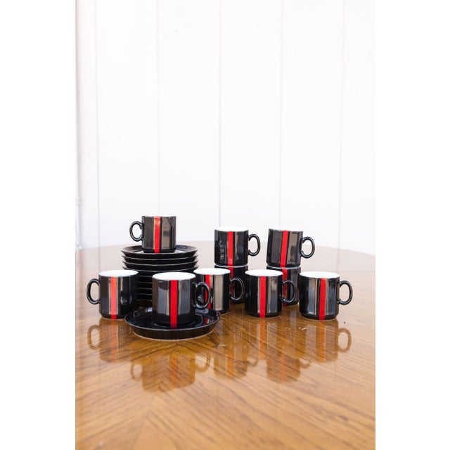 This vintage black and red set of demi tasse cups and saucers is ready for the after-party. Serve them up to 10 of your...