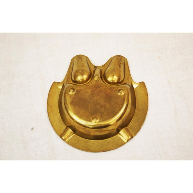 This Art Deco ash tray was manufactured in Austria in the 1930s. It is made of brass and used for pipes and cigars. It is...