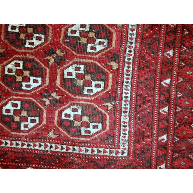 Antique Afghan Adraskand rug in original condition. The rug is in traditional colors of red, white and brown shade. The...