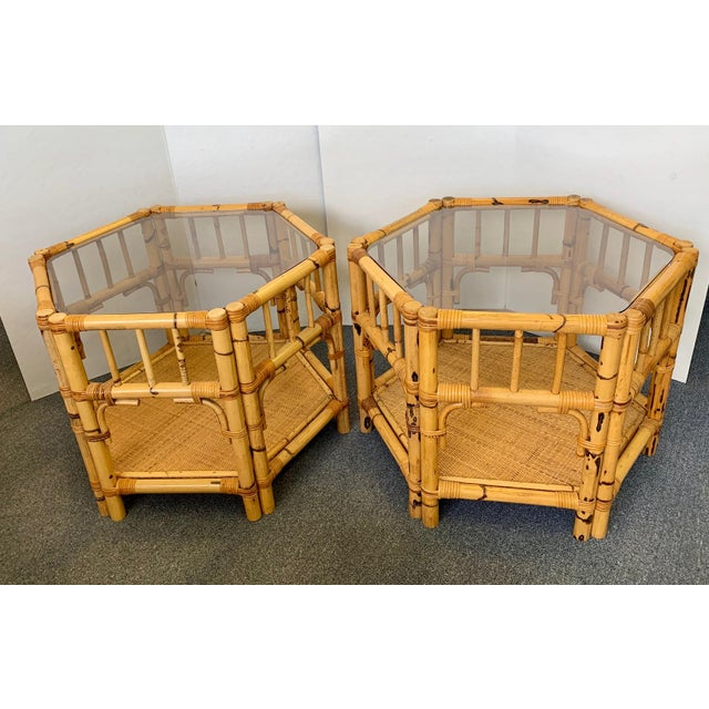 Gorgeous pair of octagonal rattan and bamboo end tables. Featuring an octagonal shaped inset glass top and low shelf. Go...