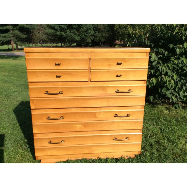 This is a beautiful solid maple upright dresser. It is from the late 1950s. They just don't make furniture like this...