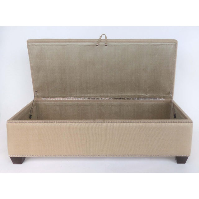 Offered for sale is an upholstered blanket chest trunk with lined interior and metal nail-heads. The lid lifts to reveal...