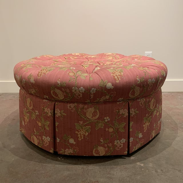 This beautiful, large, round, tufted ottoman is upholstered in Scalamandre Pomengrante fabric and has a box pleat skirt...
