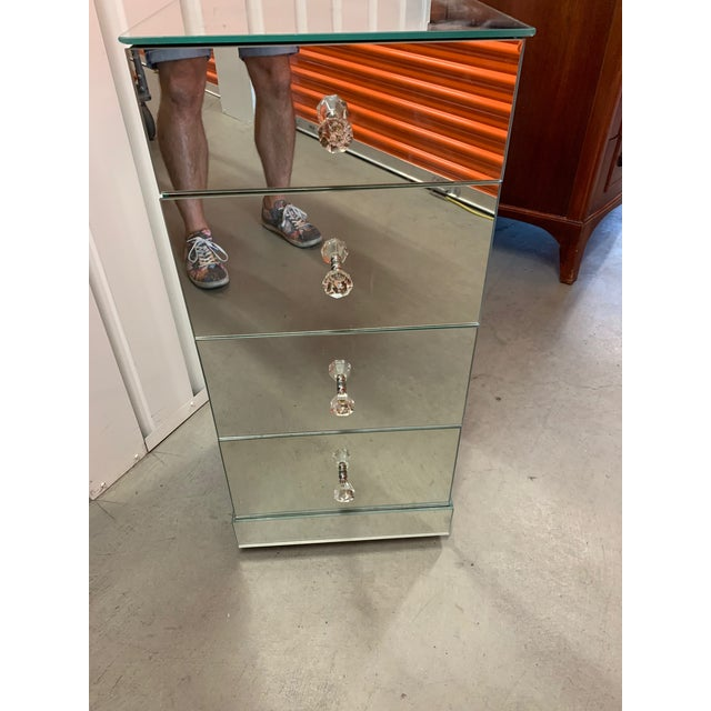 Very Unique and lovely French Antique Mirrored Nightstand. This piece has four drawers with Crystal pulls. Purchased from...