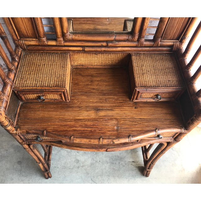 An antique finish gives this Palecek rattan vanity a decidedly English fin de siecle look. Plenty of drawer space for all...