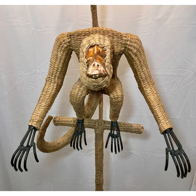 """Early Mario Lopez Torres wicker monkey floor lamp. Welded steel frame wrapped in wicker with copper face. Very tall 75""""..."""