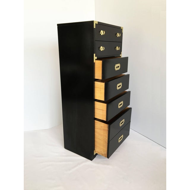 Pair of matching black lacquered seven-drawer Campaign tower chest. Accenting the are brass corner pieces and hardware....