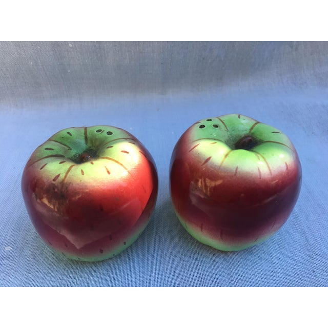 For sale is a pair of ceramic salt and pepper shakers shaped like apples. Adorable, they retain their original label as...