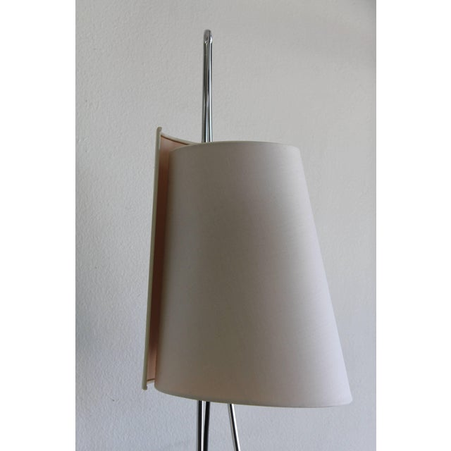 "Sculptural Italiana Luce floor lamp. One continuous chrome ""loop"" holds the lamp together and attaches to a raw,..."