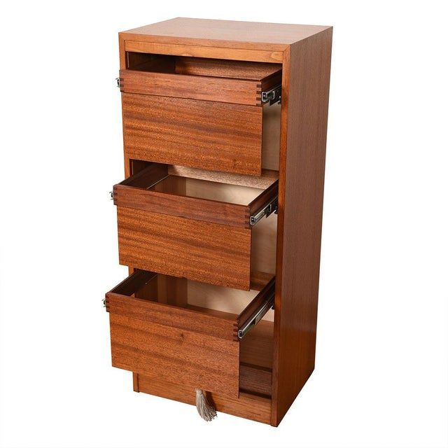 Upgrade your office with this Danish Modern filing cabinet. Pull up the tambour door to disguise the three hanging file...