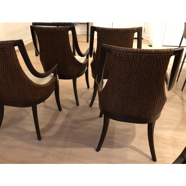 Set of four dining arm chairs. Designed in California by Artistically. Extremely comfortable and roomy.