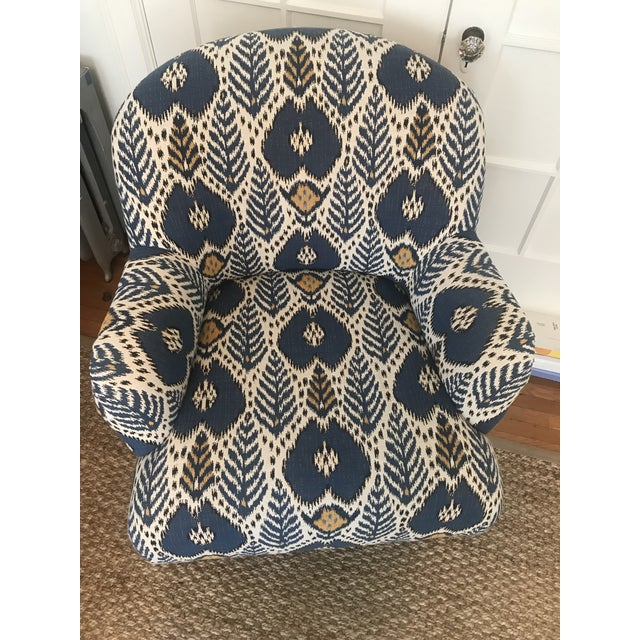 Custom Arm Chair upholstered in Brunschwig & Fils ikat fabric. Tight seat and tight back with walnut wood carved legs and...