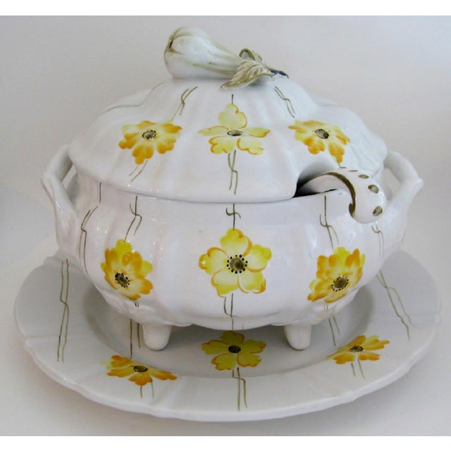 Portuguese white glazed lidded tureen with a matching platter and serving ladle. The tureen has been hand painted with...
