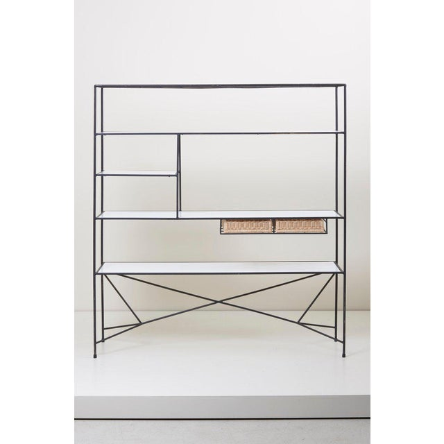 Rare Paul McCobb room divider or shelf for Arbuck in with vitrolite and cane baskets in excellent condition.