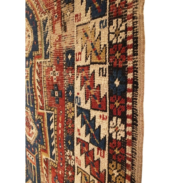 This antique Caucasian Shirvan rug was woven in the mid to late 19th Century and features a classic, yet rare keyhole...