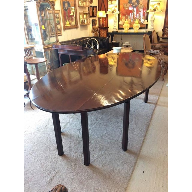 Sublime solid dark mahogany 8 foot gate leg table, with beautiful oblong shape when fully open, with two drop leaves,...