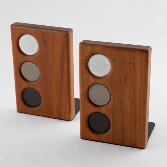 Pair of walnut bookends with inset circular ceramic tiles in white, gray and black, by Jane and Gordon Martz for Marshall...