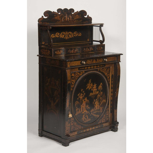 An English Japanned black and gilt chiffonier from the turn of the century.
