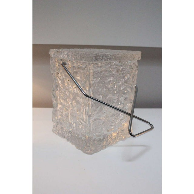A Wilardy Lucite ice bucket that has the appearance of ice. This clever bar accessory is a conversation starter. The lid...